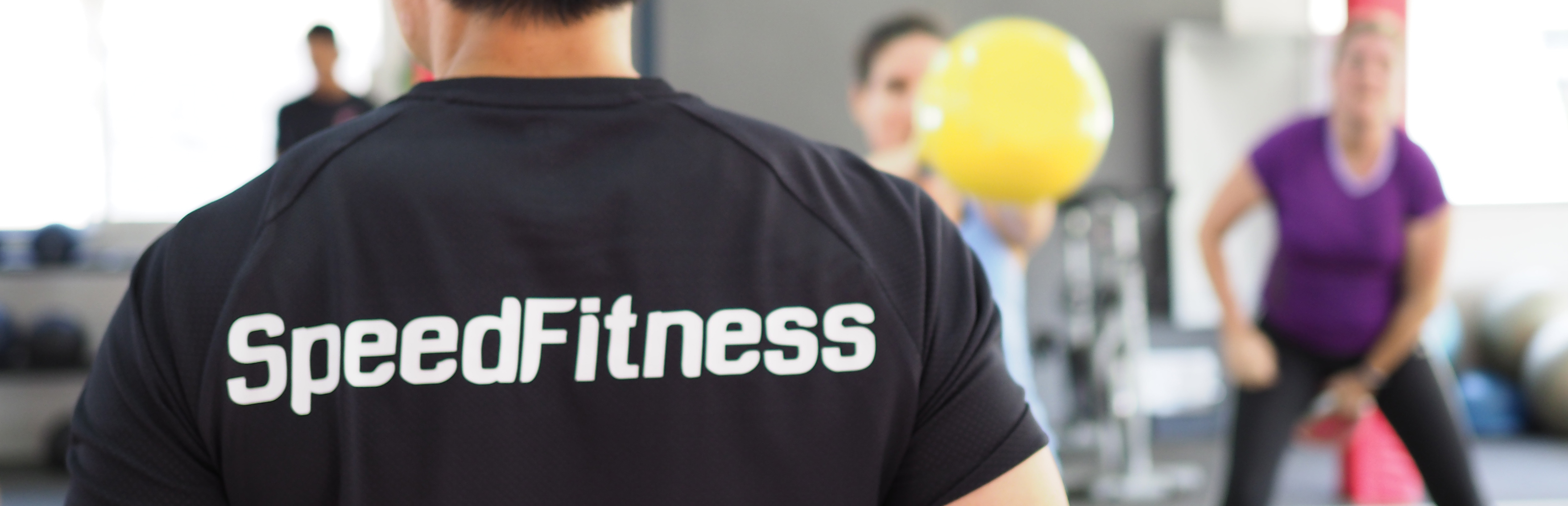 Trainer with Speed Fitness logo on shirt